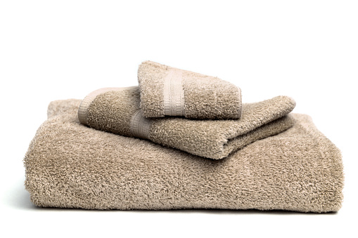 Towel「A pile of brown bath towels on a white background」:スマホ壁紙(19)