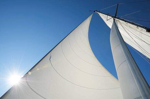 Sun shining from behind the sails of a yacht:スマホ壁紙(壁紙.com)