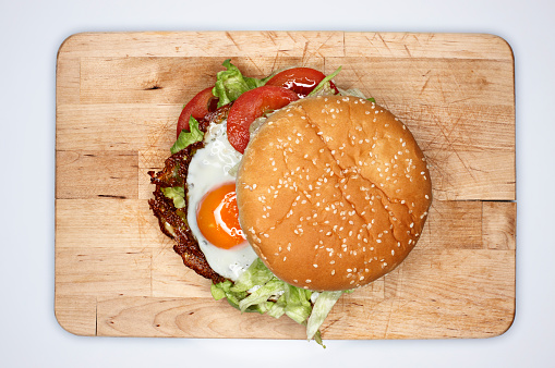 Cutting Board「Hamburger with fried eggs, elevated view」:スマホ壁紙(1)