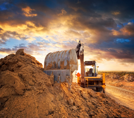 Construction Equipment「Excavator on the construction site of the road against the setting sun」:スマホ壁紙(19)