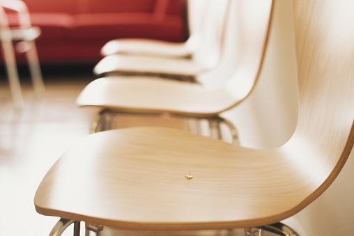 Thumbtack「Drawing pin on chair, close-up.」:スマホ壁紙(10)