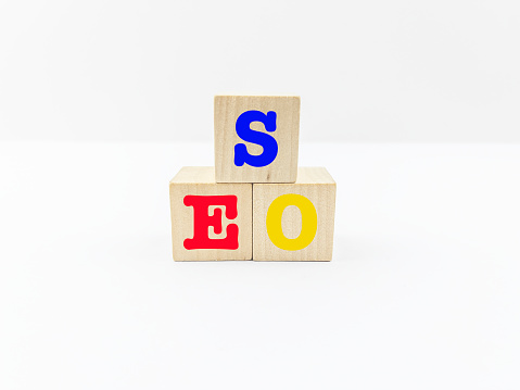 Influencer「SEO words on wooden block. White background.Search Engine Optimization (SEO) Concept.」:スマホ壁紙(4)