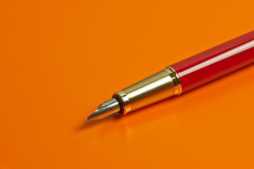 Pen「Pen On Orange Background」:スマホ壁紙(0)