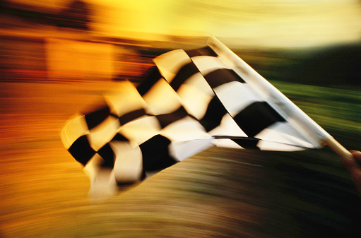 Event「Checkered flag waving at an car race.」:スマホ壁紙(12)