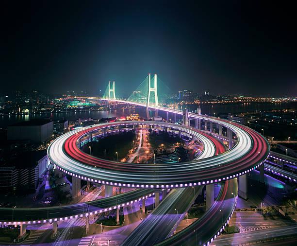 Shanghai's Nanpu bridge illuminated at night:スマホ壁紙(壁紙.com)