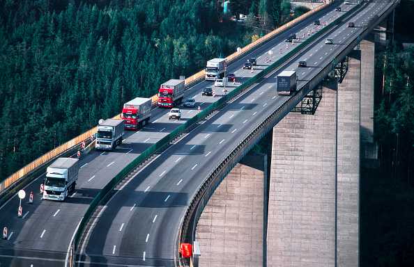 Truck「Austria. Brenner Autobahn, bridge near village of Gries; the Brenner Freeway is the most important throughway over the central Alps and connects the Austrian region of Tyrol with the Italian region of Southern Tyrol. The Brenner Freeway has a toll-charge.」:写真・画像(8)[壁紙.com]