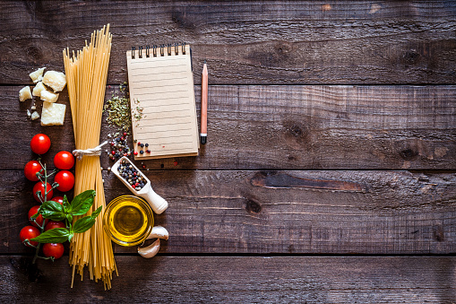 Recipe「Spagetti, ingredients and cookbook on rustic wooden table」:スマホ壁紙(0)