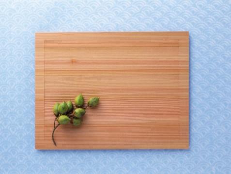水色「A wooden board and nuts, Close Up」:スマホ壁紙(1)