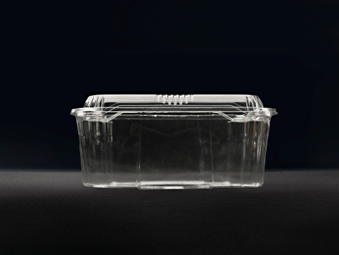 Recycling「Empty plastic container against black background」:スマホ壁紙(9)