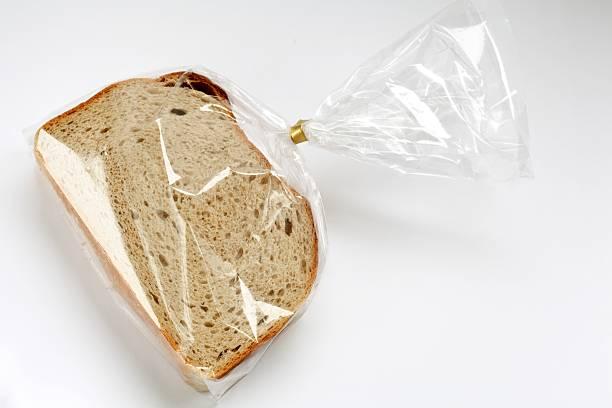 fresh sliced bread in transparent plastic folie  on white:スマホ壁紙(壁紙.com)