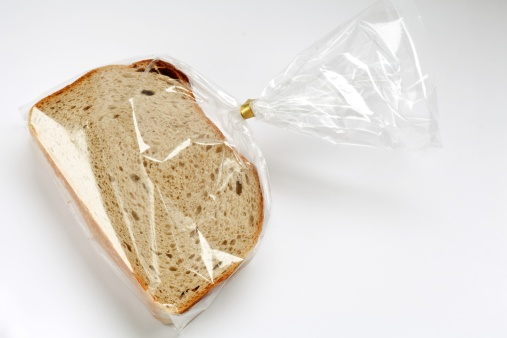 Whole Wheat「fresh sliced bread in transparent plastic folie  on white」:スマホ壁紙(13)