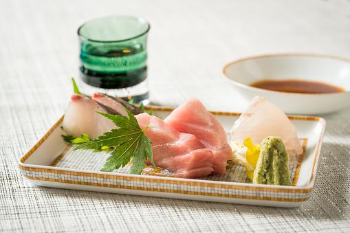 Sake「Close up of delicious sashimi on a plate」:スマホ壁紙(10)