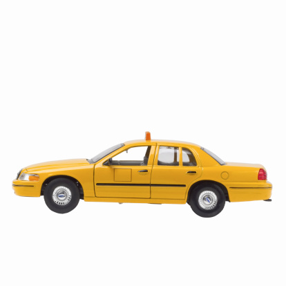 Souvenir「Close up of a model yellow taxi」:スマホ壁紙(13)