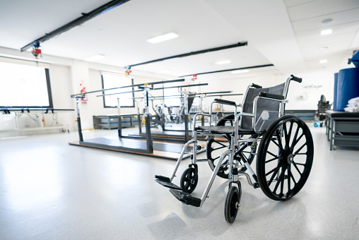 Wheelchair「Close up of a wheel chair at a physiotherapy clinic with parallel bars behind」:スマホ壁紙(17)