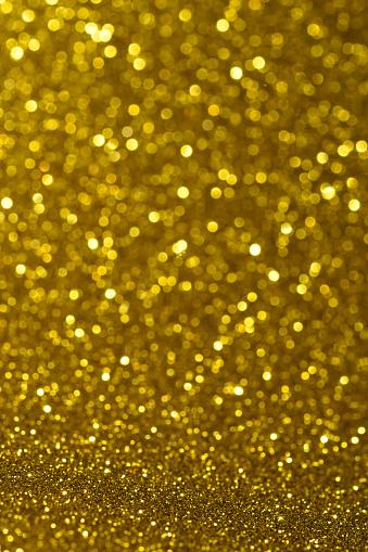 Glowing「Close up of yellow glitter」:スマホ壁紙(11)