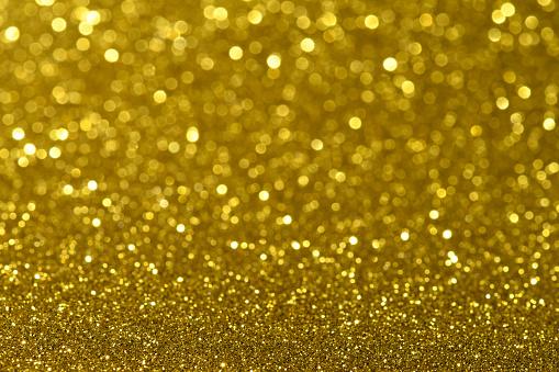 Glowing「Close up of yellow glitter creating abstract dot pattern」:スマホ壁紙(10)