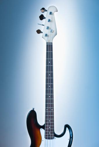 Guitar「Close up of electric guitar on blue backgrounds」:スマホ壁紙(18)
