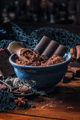 Ketogenic Diet「Close up of cocoa powder with chocolate bar into a blue bowl in old fashioned style」:スマホ壁紙(17)