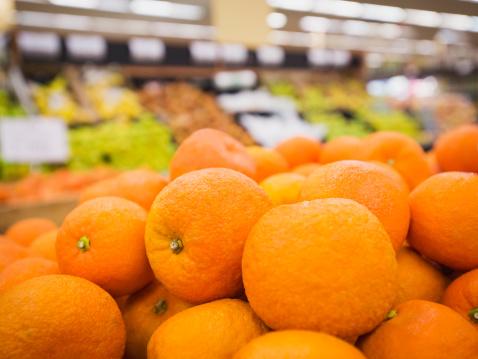 Orange - Fruit「Close up of fruit for sale in grocery store」:スマホ壁紙(8)
