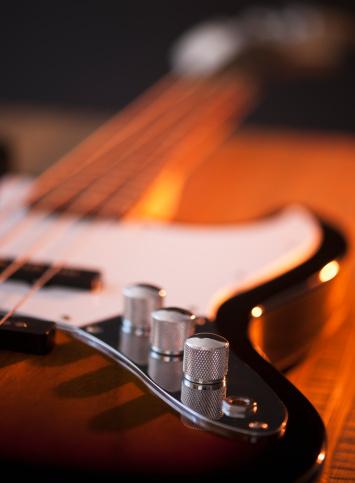 Rock Music「Close up of volume knobs of bass guitar」:スマホ壁紙(9)