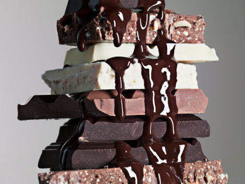 Temptation「Close up of chocolate syrup dripping over stack of chocolate bars」:スマホ壁紙(5)