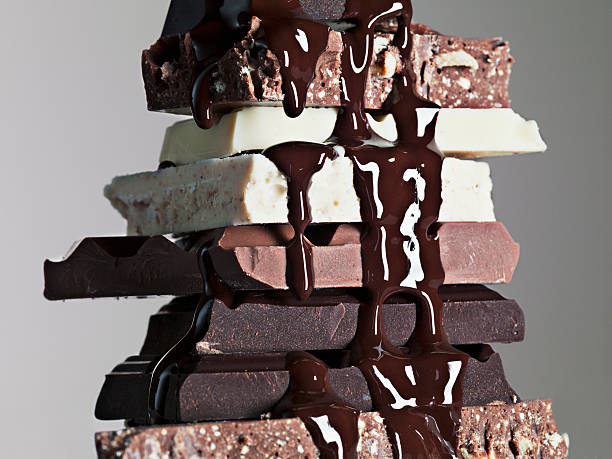 Close up of chocolate syrup dripping over stack of chocolate bars:スマホ壁紙(壁紙.com)