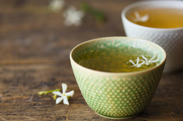 Close up of jasmine tea in teacup:スマホ壁紙(壁紙.com)