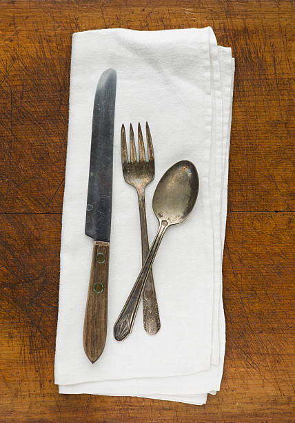 Close up of silver forks, knife and spoon on napkin:スマホ壁紙(壁紙.com)