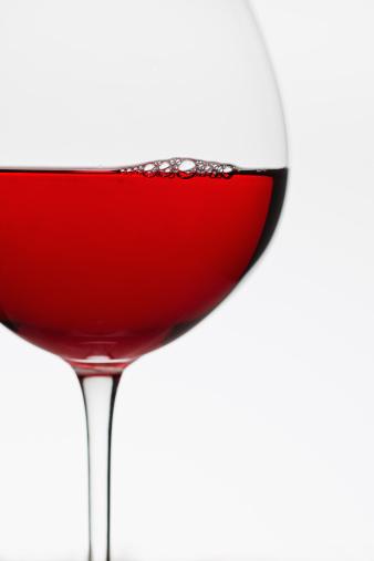 半透明「Close up of glass of red wine on white background」:スマホ壁紙(19)