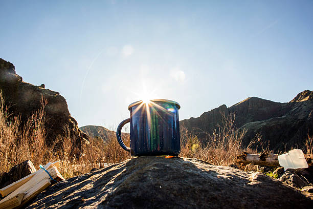 Close up of camping mug under remote mountains:スマホ壁紙(壁紙.com)