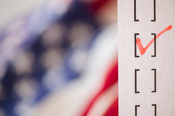 Close up of voting ballot near American flag:スマホ壁紙(壁紙.com)
