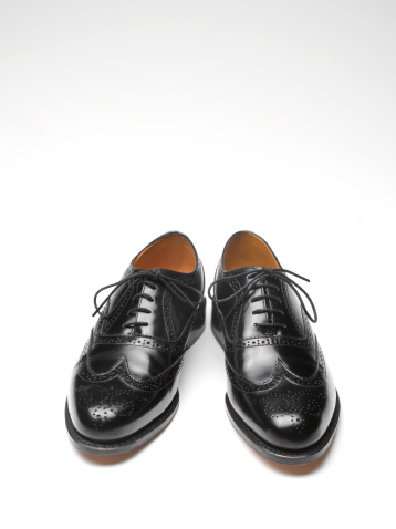 Formalwear「Close up of black brogue shoes with copy space」:スマホ壁紙(13)