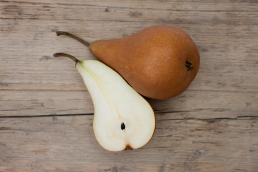 Pear「Close up of pear and pear slice on wooden board」:スマホ壁紙(18)