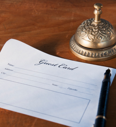 Hotel Reception「Close up of antique guest card and service bell」:スマホ壁紙(8)