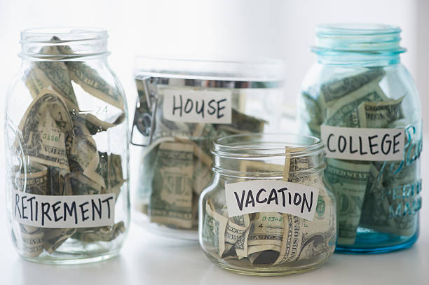 Close up of savings jars with money:スマホ壁紙(壁紙.com)