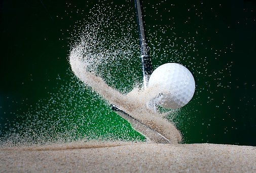 Sand Trap「Close up of golf club hitting ball in bunker」:スマホ壁紙(9)