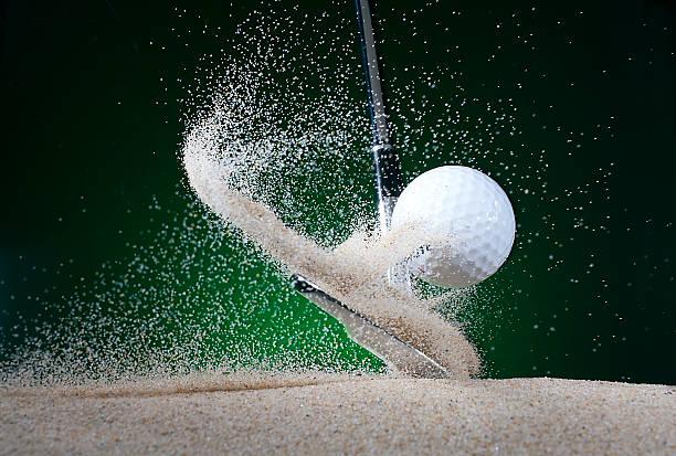Close up of golf club hitting ball in bunker:スマホ壁紙(壁紙.com)