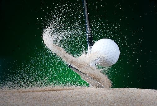 Sand Trap「Close up of golf club hitting ball in bunker」:スマホ壁紙(7)