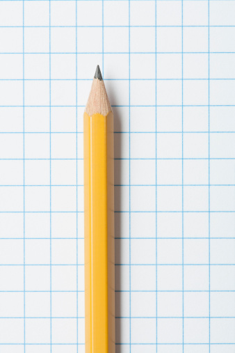 Lead「Close up of single yellow sharpened pencil on graph paper」:スマホ壁紙(12)