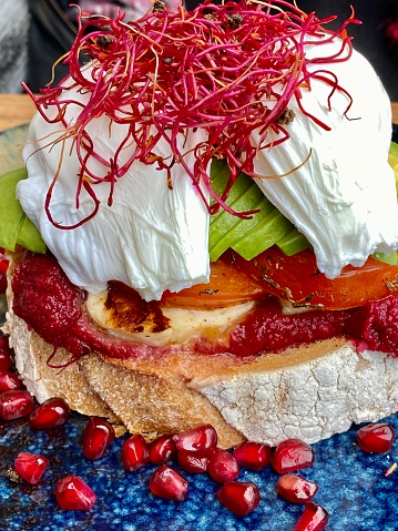 Poached Food「Close up of poached eggs and layered gourmet breakfast」:スマホ壁紙(5)