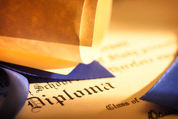 Close up of a graduation diploma:スマホ壁紙(壁紙.com)