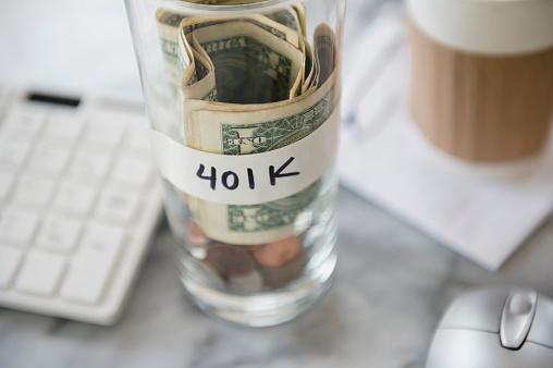 Efficiency「Close up of savings cup on office desk」:スマホ壁紙(17)