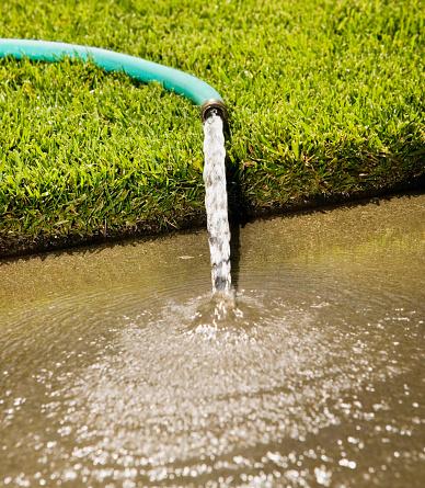 Hose「Close up of hose pouring onto sidewalk」:スマホ壁紙(8)