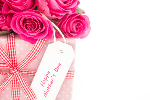母の日「Close up of a bouquet of pink roses next to a pink gift with a happy mothers day card on a white bac」:スマホ壁紙(4)