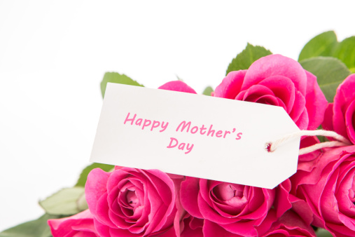 母の日「Close up of a beautiful bouquet of pink roses with a happy mothers day card on a white background」:スマホ壁紙(0)