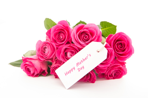 母の日「Close up of a beautiful bouquet of pink roses with a happy mothers day card on a white background」:スマホ壁紙(4)