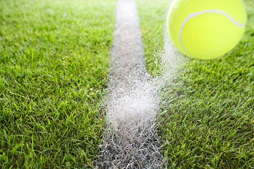 テニス「Close up of tennis ball hitting chalk line」:スマホ壁紙(16)