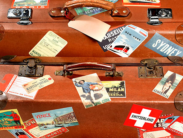 Close up of suitcase with travel stickers:スマホ壁紙(壁紙.com)