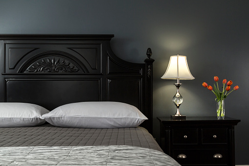 Bed - Furniture「Close up of Black Painted Bed in Modern Bedroom Interior with Painted Walls of Gray and Black, Bedside Tulips in Vase」:スマホ壁紙(16)