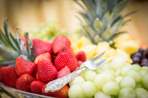 Buffet「Close up of fruit tray with strawberries, grapes and pineapple at a party buffet」:スマホ壁紙(14)